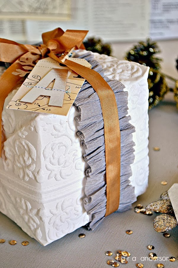 Tara Anderson's vintage wallpaper gift wrap with ruffled crepe paper and ribbon