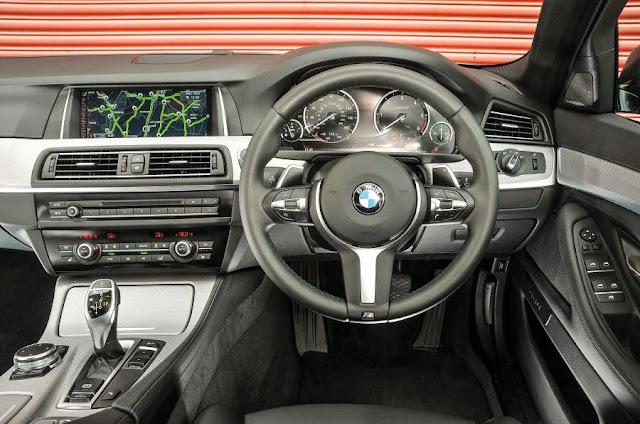 Compare Among BMW 5 Series vs Jaguar XF  interior dashboard