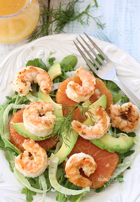 Grilled shrimp, slices of avocado, shaved fennel and oranges are ...