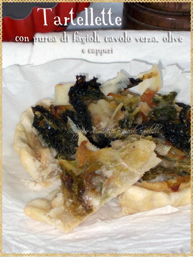 Tartellette con purea di fagioli, cavolo verza, olive e capperi, fetta