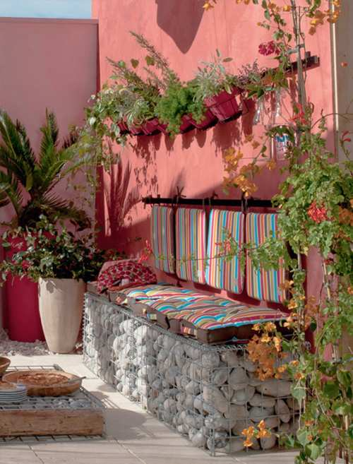 Decoraci n decoracion decorar una terraza con poco dinero for Decorar paredes patio exterior