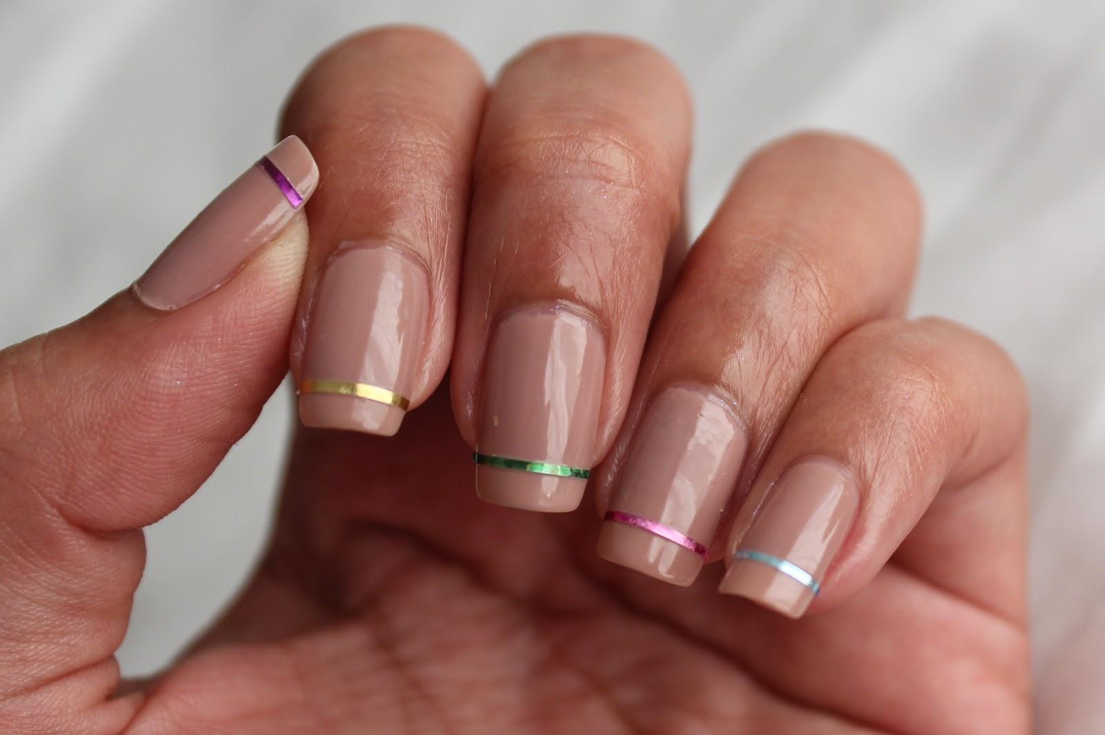 Nail art glamorously done foiled rainbow nail art tips - Nail art nude ...