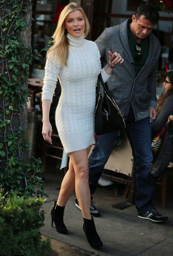 We will be bewildered to Joanna Krupa's girlish, fun style.  The Poland beauty was a mix of trends at Los Angeles, USA on Thursday, December 18, 2014 with her husband, Romain Zago and a cute pet.