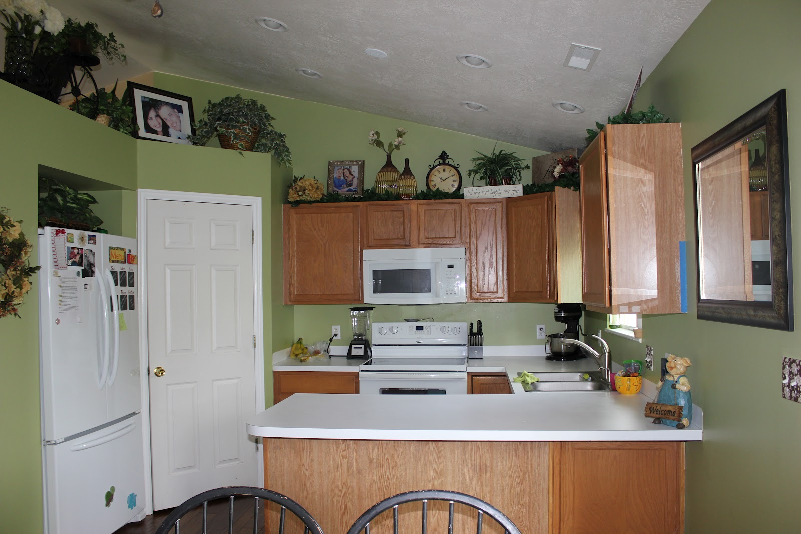 Green Color Kitchen Walls with Oak Cabinets