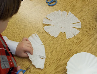Cutting coffee filter snowflakes (Brick by Brick)