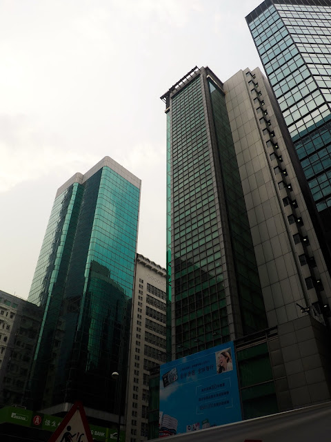 Glass window skyscrapers on Nathan Road in Mong Kok, Kowloon, Hong Kong