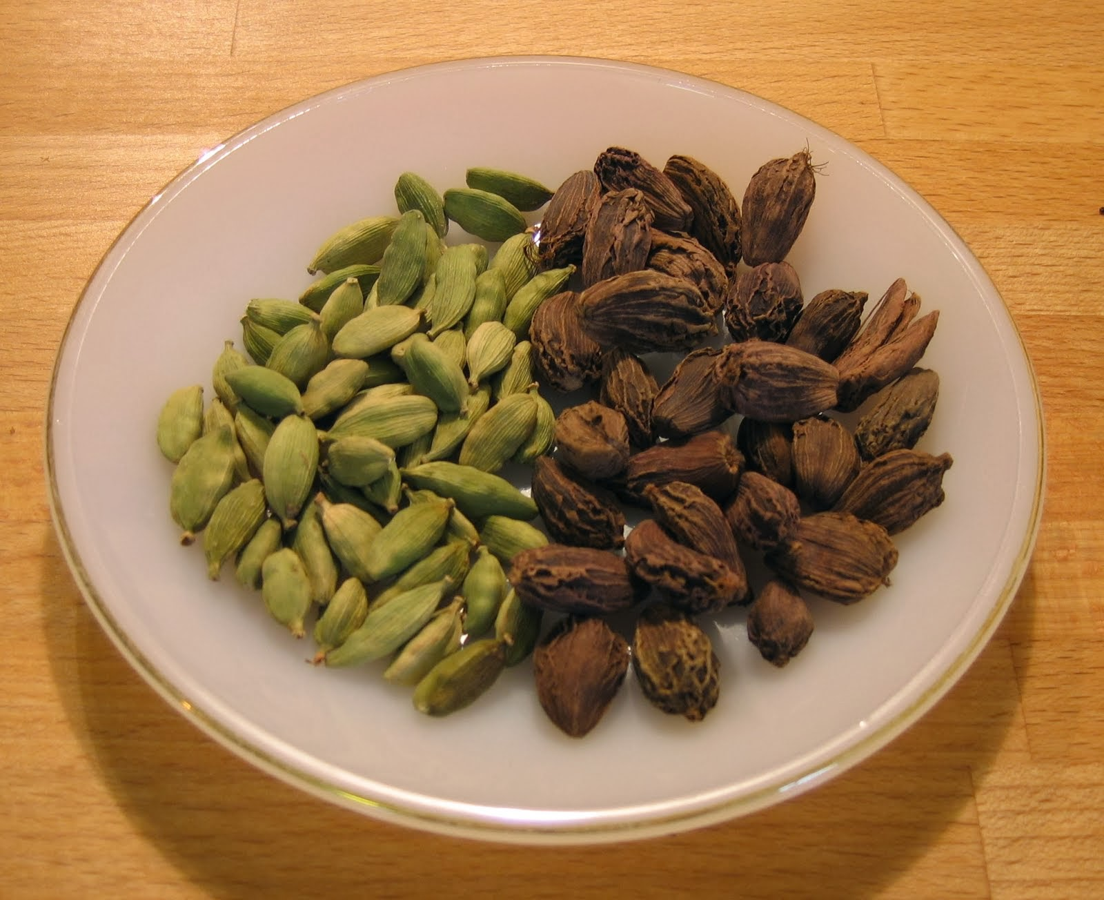 Green and black cardamoms