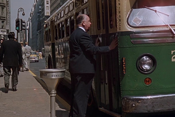 Alfred Hitchcock in North by Northwest 1959 movieloversreviews.blogspot.com