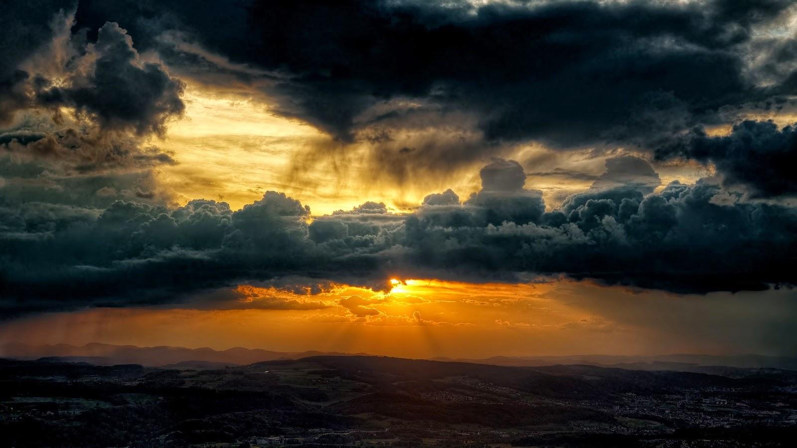 dark_clouds_sky_sun-1600x900.jpg