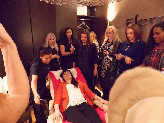 A blogger in the massage chair at the Elemis Treatment Room at Harvey Nichols Leeds