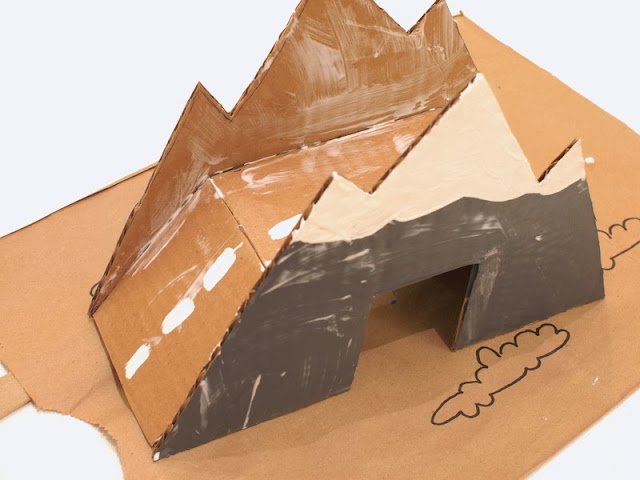 Paint and cover your cardboard bridge with Mod Podge