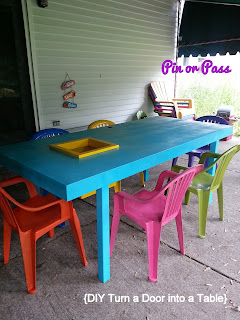 Brightly colored outdoor table made from an old door and spray painted chairs