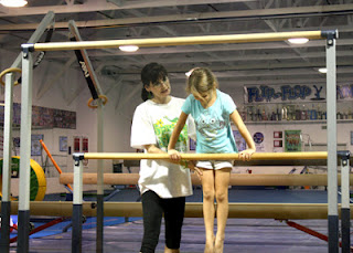 Tessa on bars during summer camp.