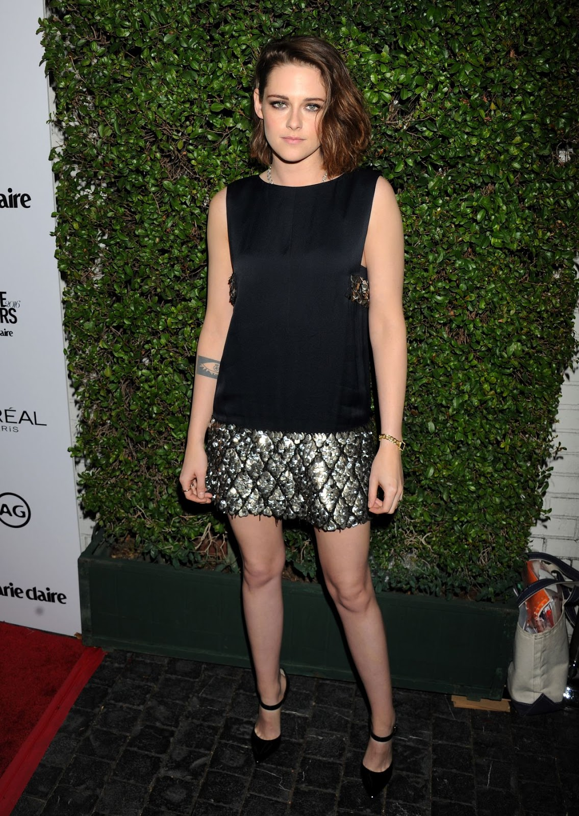 Kristen Stewart shows off legs in a sequinned mini dress at the Image Maker Awards in LA