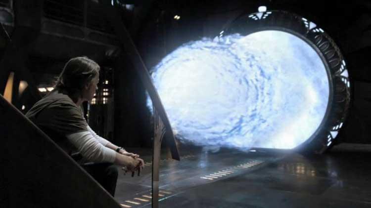"Rush sits near the Stargate in SGU's ""Time"""