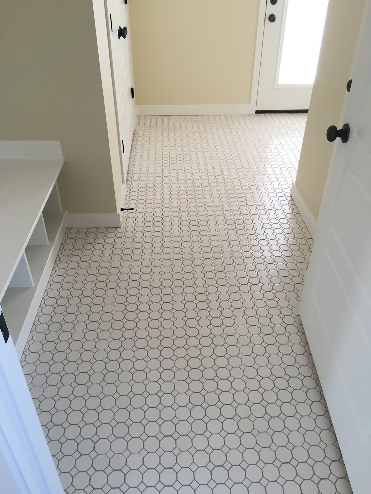Top design must haves when building a home floor tile luxe octagon mosaic luxe white oct 2 with white dot dailygadgetfo Gallery
