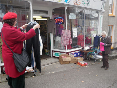 Dressed head to foot in charity shop clobber