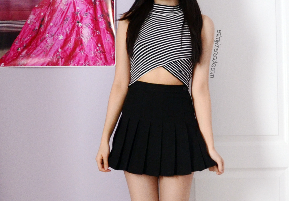 Front view of the striped asymmetric mock-neck crop top from JollyChic.