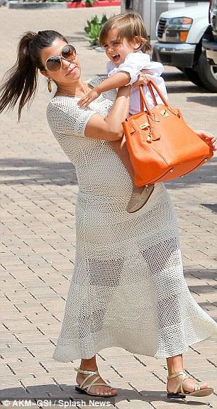 kourtney kardashian bolsa hermes laranja
