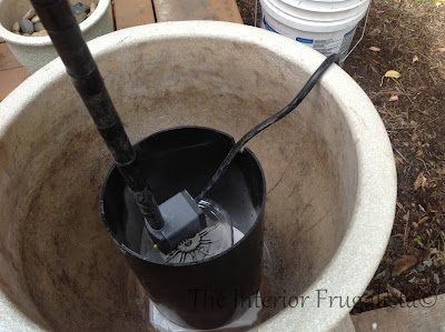 Step Four of building a plant pot water fountain