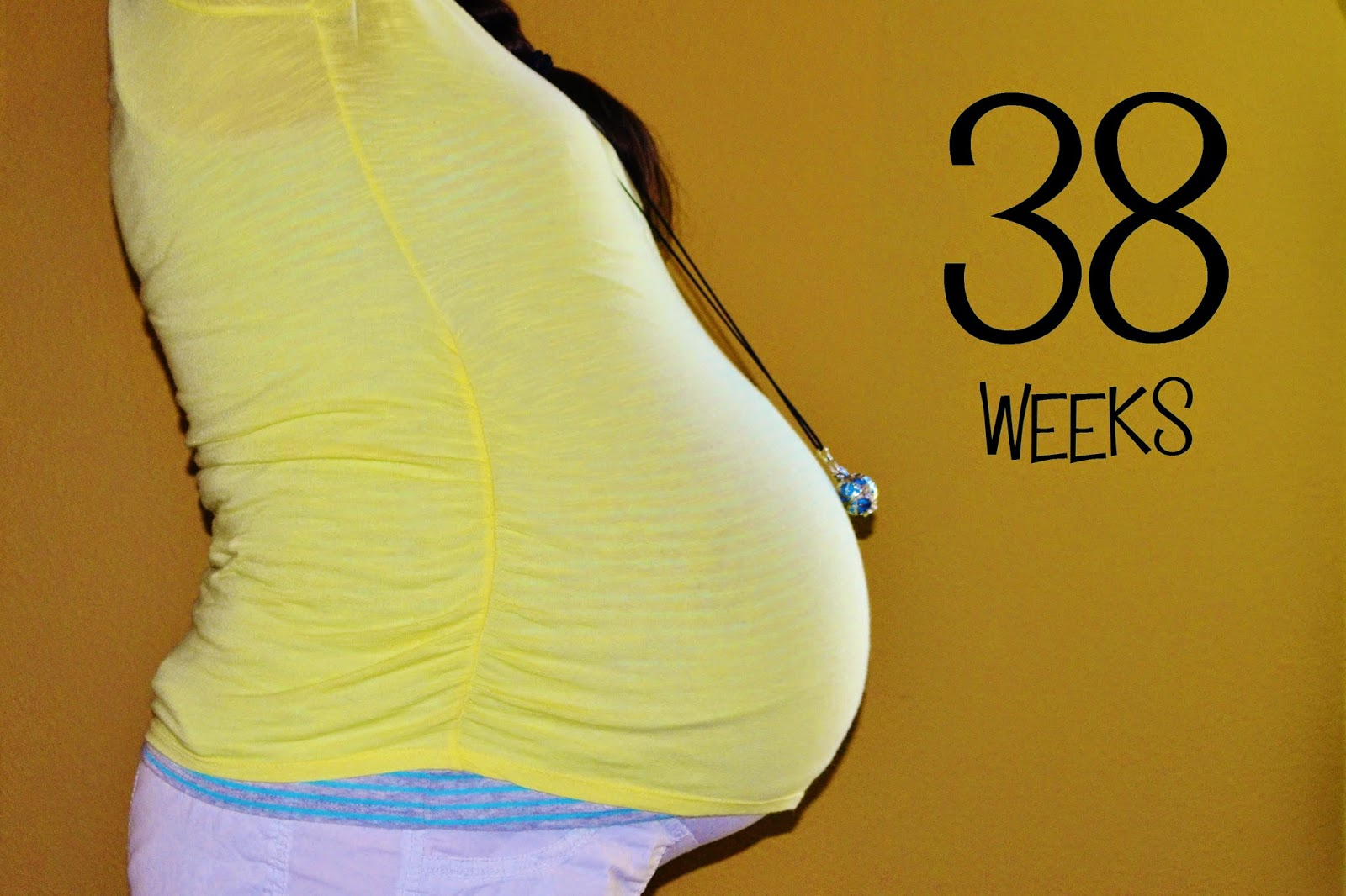Surrogate pregnant belly at 38 weeks
