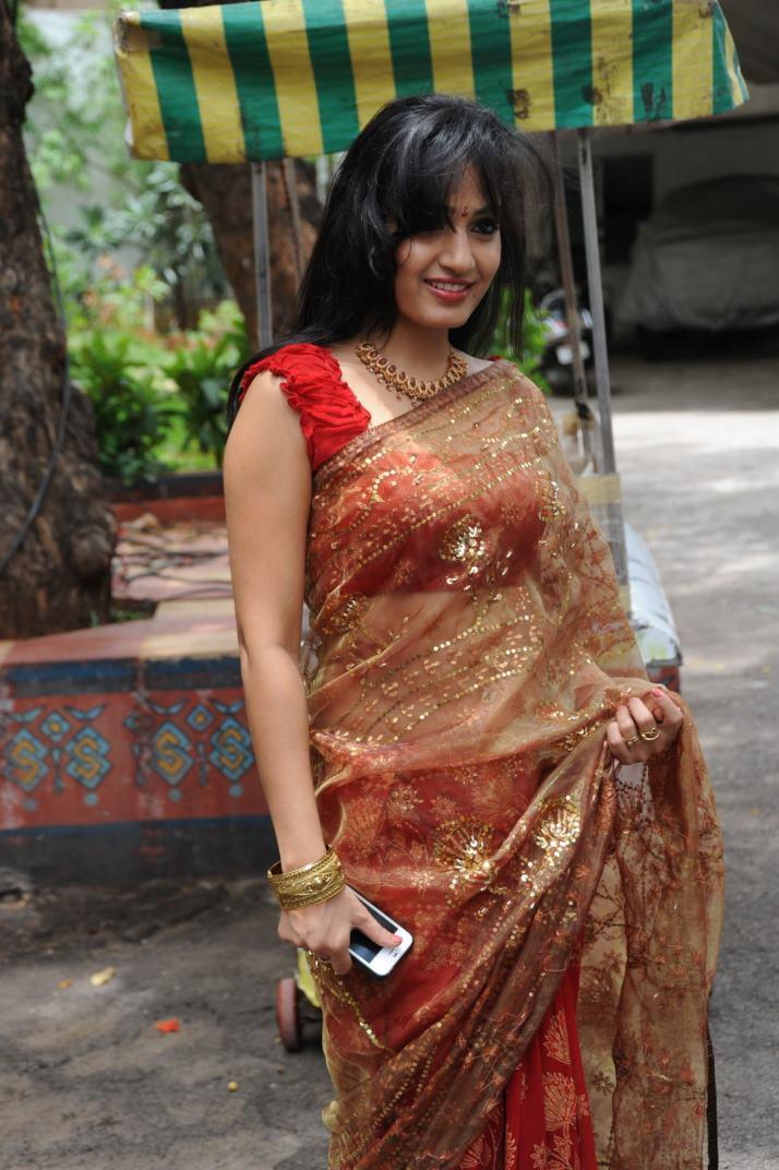 Madhavi Latha in Spicy Sleeveless Purple Leg Split Gown Spicy Pics