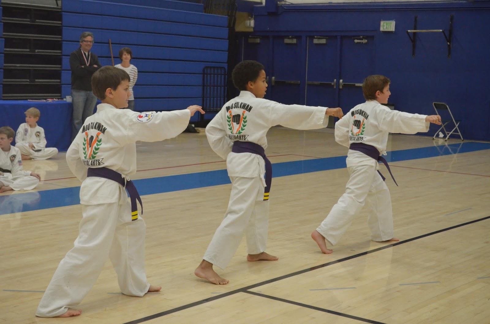 Purple belt martial arts kids doing a patterned movement form