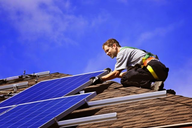 Solar panels being installed on roof (Credit: Shutterstock) Click to enlarge.
