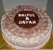"Tiramisu cake @ RM70 (9"") RM55 (7"")"