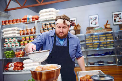 Jay Ducote gives the finishing touch to a dish on The Next Food Network Star.