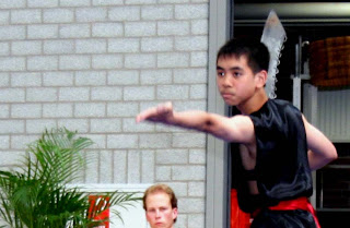 young kung fu ninja practicing martial arts with dadao great sword saber