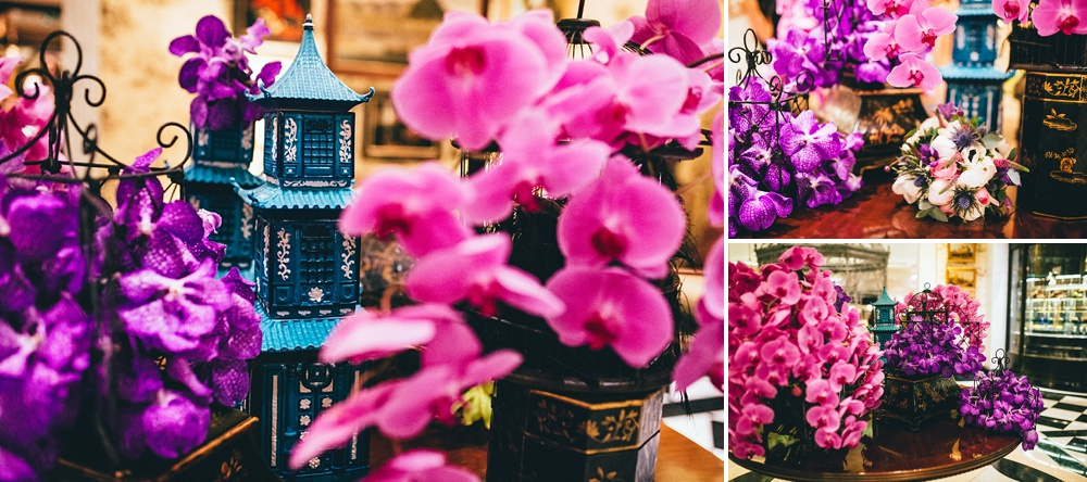 pretty details of floral display in the savoy hotel central london. pink and purple flowers.