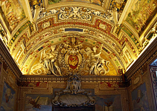 painted architecture at end of corridor at the sistine chapel