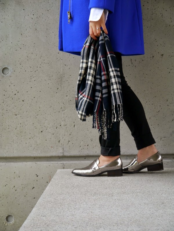 Silver metallic loafers with a tartan scarf and colourful coat