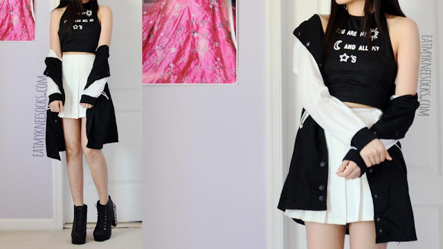 A sporty-casual monochrome outfit, featuring Dresslink's longline baseball jacket and printed crop top, worn with a white American Apparel pleated tennis skirt.