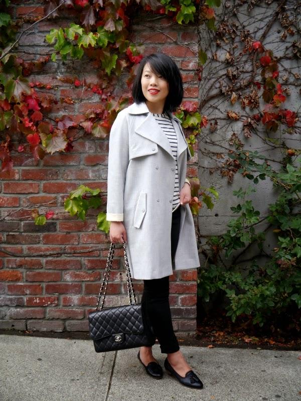 Oversize grey trench, Breton striped top, black skinny jeans, black Chanel 2.55, black tassel slippers