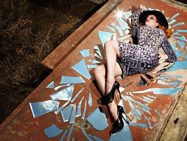 Christina Hendricks laying in broken glass