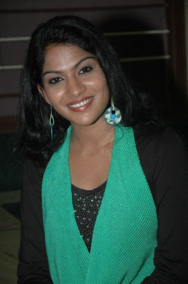 swasika in black dress at event