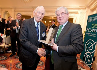 In Atlanta on Friday, Irish Foreign Minister Eamon Gilmore (right) presented Don Keough, former president of Coca-Cola, with the Presidential Distinguished Service Award for the Irish Abroad.