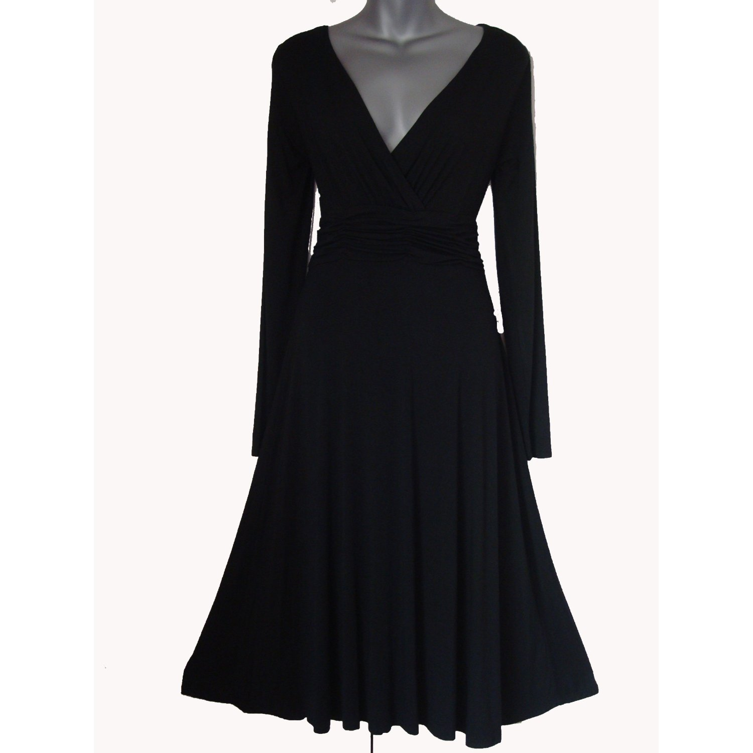 Simple black dress it has a bit of stretch to accomodate christmas