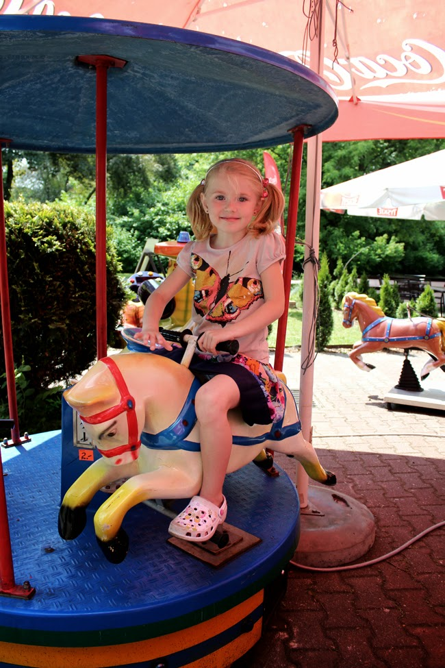 girl's world, poland, zoo, riding on a carrousel