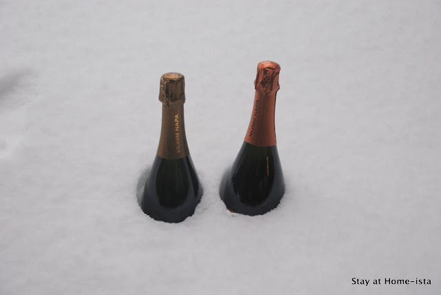 chill bottles of champagne in the snow