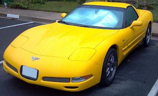 a yellow corvette coupe 2003