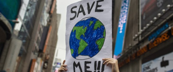 """""""Save Me!!!"""" sign (Credit: Bloomberg via Getty Images) Click to Enlarge."""