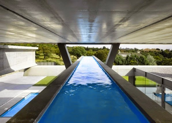 Swimming Pool with a Glass Barrier and Prominent out Home design