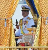 Thai Crown Prince Maha Vajiralongkorn sits on the Royal Barge during the Royal Barge Procession on the Chao Phraya River in Bangkok November 9, 2012.