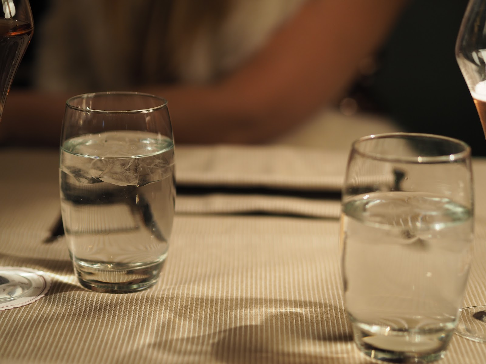 water glasses on striped table cloth