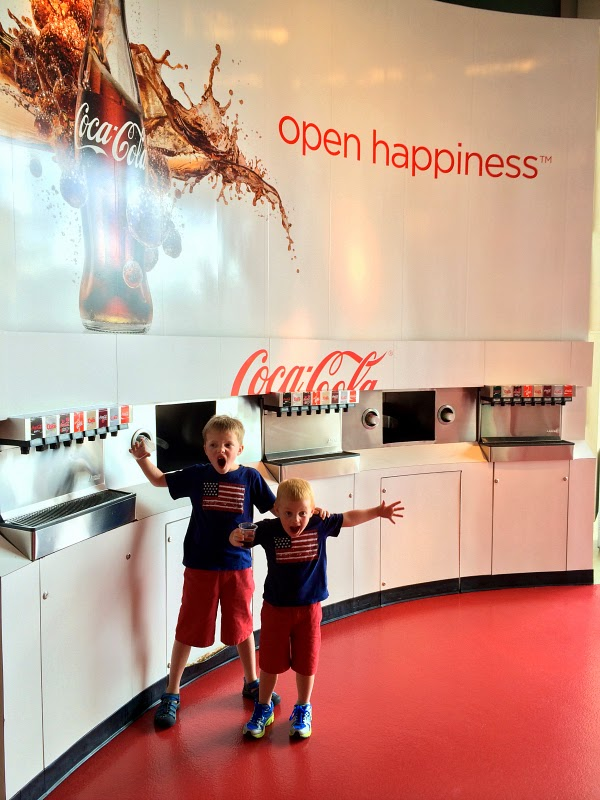 boys excited about drinking coca cola