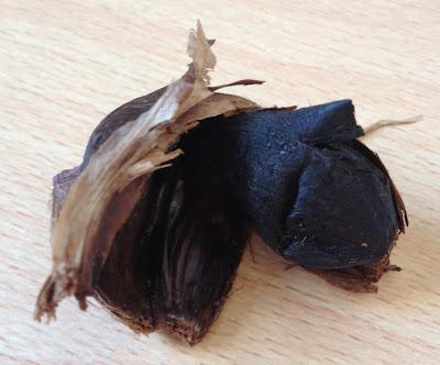 close up black garlic clove