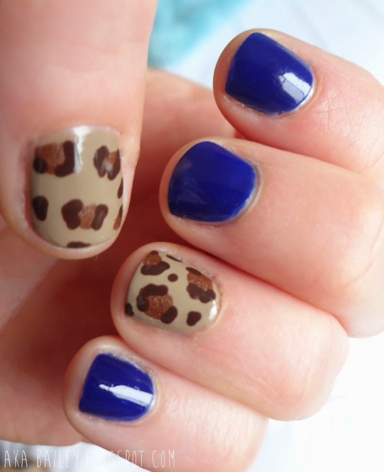 Navy nails with leopard print accent